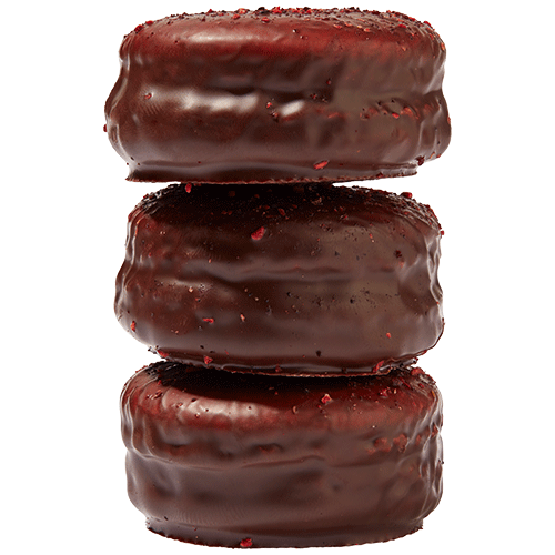 Dark chocolate coated raspberry macaron